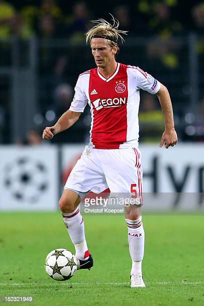 Christian Poulsen of Amsterdam runs with the ball during the UEFA Champions League group D match between Borussia Dortmund and Ajax Amsterdam at...