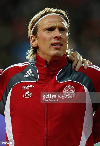 Christian Poulsen of Denmark stands for the national anthem during the FIFA 2010 group one World Cup Qualifying match between Denmark and Hungary at...