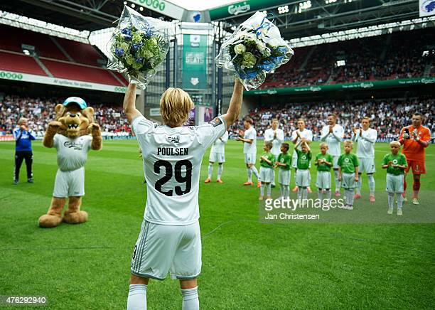 Christian Poulsen of FC Copenhagen playing his last match for FC Copenhagen and receiving flowers prior to the Danish Alka Superliga match between FC...