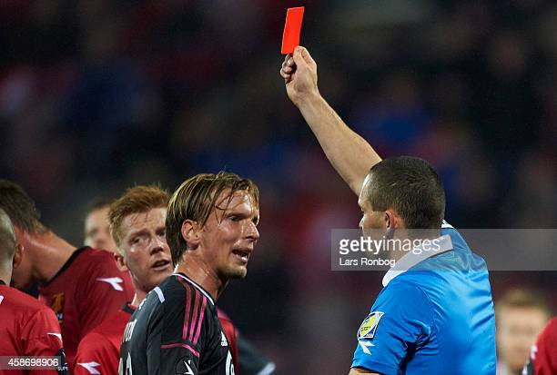Christian Poulsen of FC Copenhagen receives a red card from Referee MadsKristoffer Kristoffersen during the Danish Superliga match between FC...