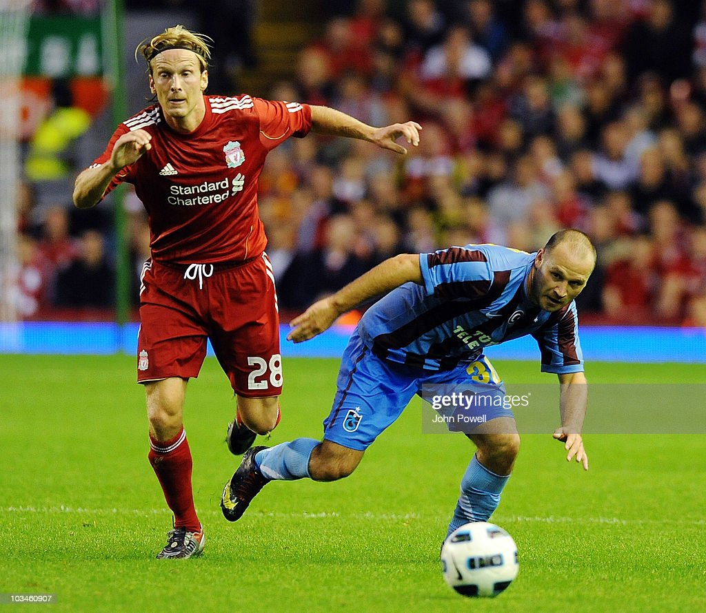 <a gi-track='captionPersonalityLinkClicked' href=/galleries/search?phrase=Christian+Poulsen&family=editorial&specificpeople=228068 ng-click='$event.stopPropagation()'>Christian Poulsen</a> of Liverpool tussles with Serkan Balci of Trabzonspor AS during the UEFA Europa League, Play off, first leg Qualifying match between Liverpool and Trabzonspor at Anfield on August 19, 2010 in Liverpool, England.