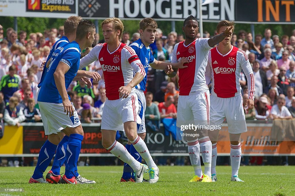 Christian Poulsen, Stefano Denswil of Ajax during the pre season friendly match between SDC Putten and Ajax on June 29, 2013 in Putten, The Netherlands.