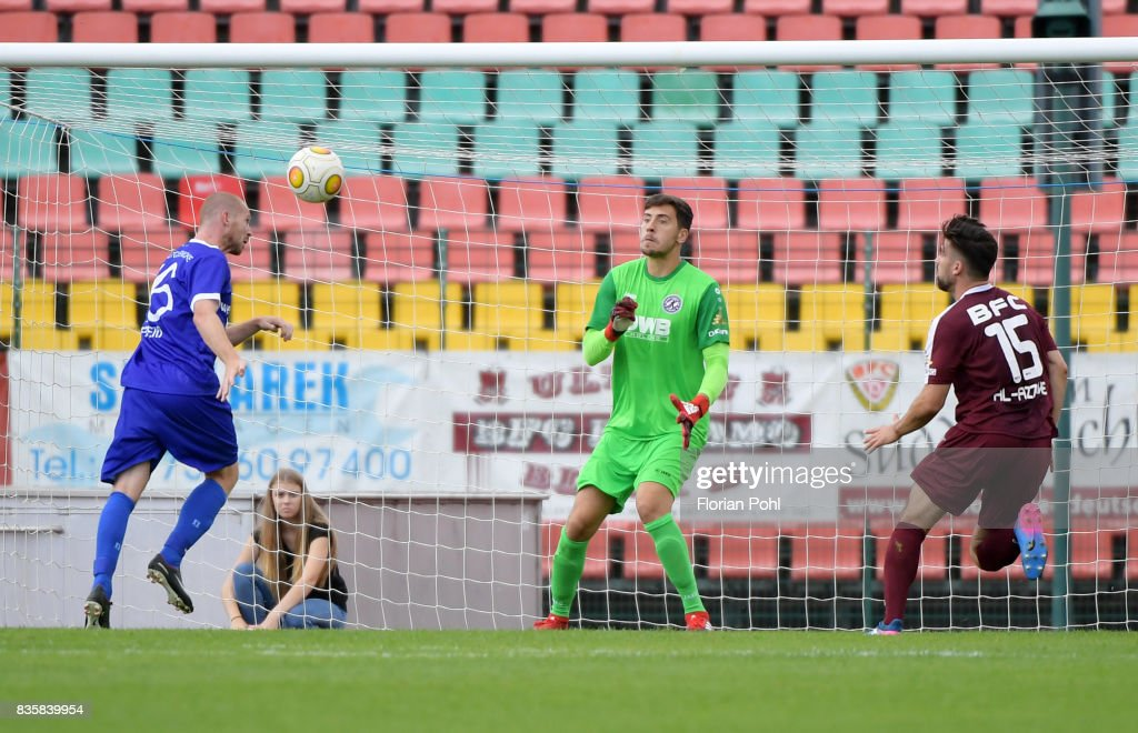 Christian Preiss of VSG Altglienicke scores the 1:2 against Bernhard Hendl of BFC Dynamo during the game between BFC Dynamo Berlin and VSG Altglienicke on august 20, 2017 in Berlin, Germany.