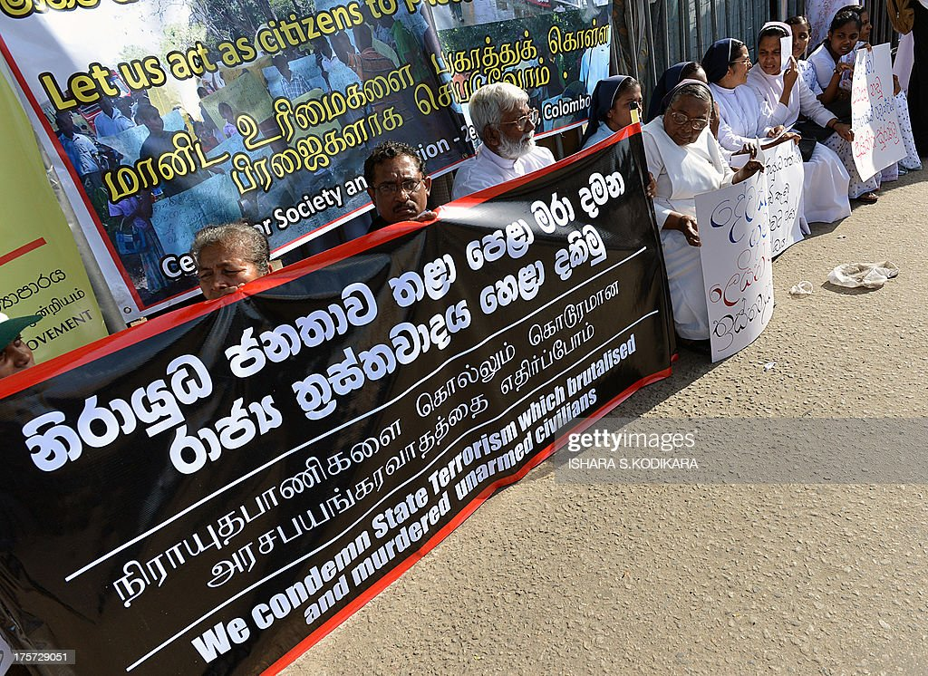 Christian priests and nuns stage a demonstration in Sri Lanka's capital Colombo on August 7, 2013 to denounce the August 1 military crackdown of a protest by villagers against the contamination of their ground water supply at a village just outside Colombo. The protest came as the Archbishop of Colombo, Cardinal Malcolm Ranjith criticised the Sri Lankan army for violating the sanctity of a Catholic church by storming it an assaulting unarmed civilians sheltering there to protect from an army shooting that killed three people and wounded 50. AFP PHOTO/ Ishara S. KODIKARA