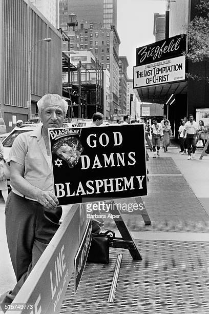 A Christian protesting outside the Ziegfeld Theater in Manhattan at the portrayal of Christ in Martin Scorsese's film 'The Last Temptation of Christ'...