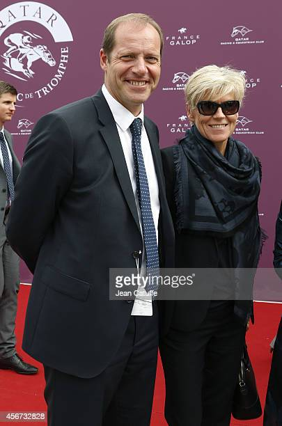 Christian Prudhomme and his wife attend the Qatar Prix de I'Arc de Triomphe at Longchamp racecourse on October 5 2014 in Paris France