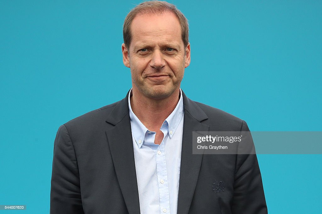 <a gi-track='captionPersonalityLinkClicked' href=/galleries/search?phrase=Christian+Prudhomme&family=editorial&specificpeople=546988 ng-click='$event.stopPropagation()'>Christian Prudhomme</a>, director of Le Tour de France stands on stage during the team presentation ahead of the 2016 Le Tour de France on June 30, 2016 in Sainte-Mere-Eglise, France.