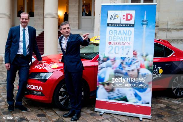 Christian Prudhomme Tour de France race director poses with Duesseldorf Lord Mayor Thomas Geisel after a press conference in Paris on January 14 2015...