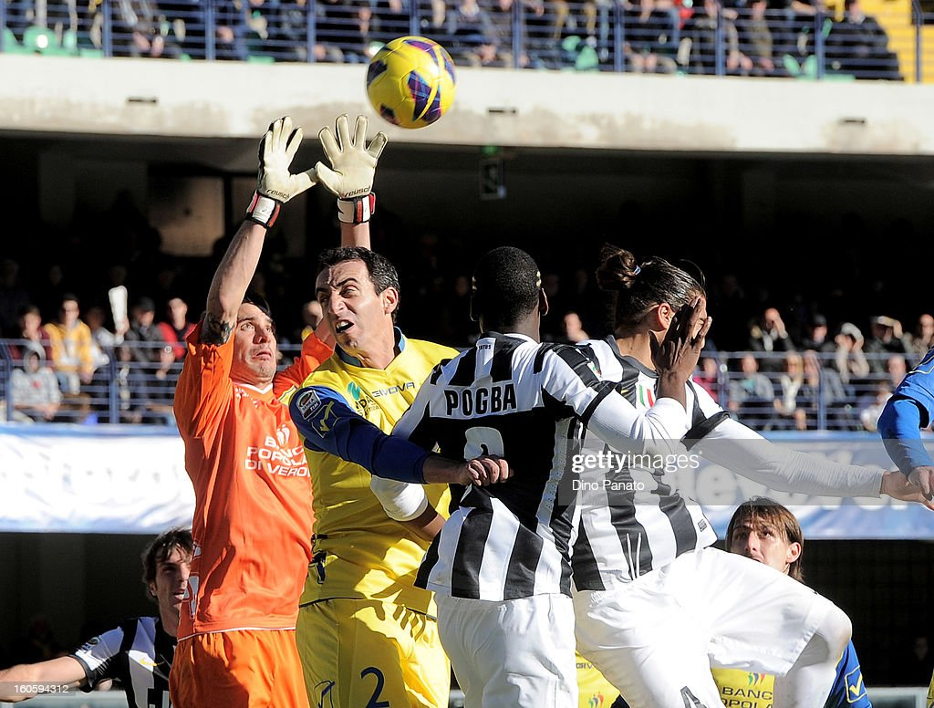 Christian Puggioni goalkeeper (L)and <a gi-track='captionPersonalityLinkClicked' href=/galleries/search?phrase=Dario+Dainelli&family=editorial&specificpeople=179389 ng-click='$event.stopPropagation()'>Dario Dainelli</a> (2rd L) of Chievo Verona compete with <a gi-track='captionPersonalityLinkClicked' href=/galleries/search?phrase=Paul+Pogba&family=editorial&specificpeople=5805302 ng-click='$event.stopPropagation()'>Paul Pogba</a> (3rd R) and Martin Caceres of Juventus during the Serie A match between AC Chievo Verona and Juventus FC at Stadio Marc'Antonio Bentegodi on February 3, 2013 in Verona, Italy.