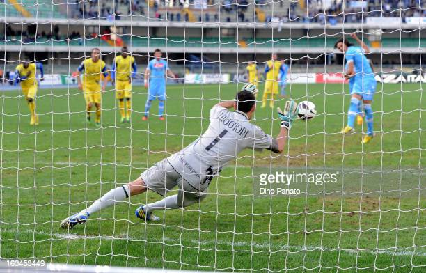 Christian Puggioni goalkeeper of AC Chievo Verona saves a penalty from Edison Cavani of SSC Napoli during the Serie A match between AC Chievo Verona...