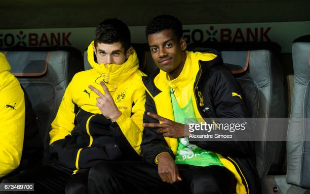 Christian Pulisic and Alexander Isak of Borussia Dortmund prior to the DFB Cup Semi Final match between FC Bayern Muenchen and Borussia Dortmund at...