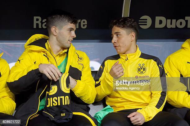 Christian Pulisic and Emre Mor of Dortmund sit on the bench before the Bundesliga soccer match between 1 FC Cologne and Borussia Dortmund at the...