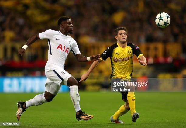 Christian Pulisic of Borussia Dortmund and Davinson Sanchez of Tottenham Hotspur battle for possession during the UEFA Champions League group H match...