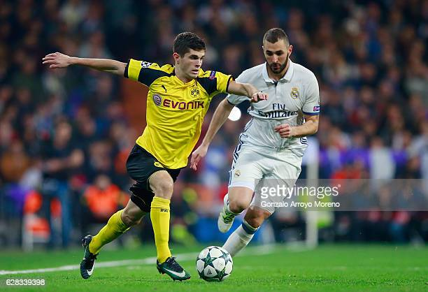 Christian Pulisic of Borussia Dortmund and Karim Benzema of Real Madrid battle for possession during the UEFA Champions League Group F match between...