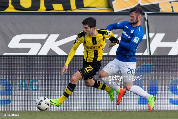 Christian Pulisic of Borussia Dortmund and Marcel Heller of SV Darmstadt battle for the ball during the Bundesliga match between SV Darmstadt 98 and...