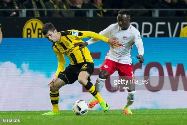Christian Pulisic of Borussia Dortmund and Naby Keita of RB Leipzig battle for the ball during the Bundesliga soccer match between Borussia Dortmund...