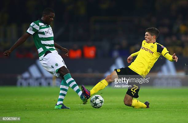 Christian Pulisic of Borussia Dortmund and William Carvalho of Sporting CP during the UEFA Champions League Group F match between Borussia Dortmund...