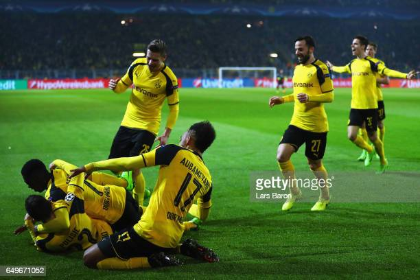 Christian Pulisic of Borussia Dortmund celebrates after he shoots and scores his teams second goal with team mates during the UEFA Champions League...