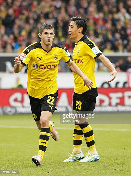 Christian Pulisic of Borussia Dortmund celebrates with Shinji Kagawa after scoring the second goal during the Bundesliga match between VfB Stuttgart...