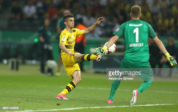 Christian Pulisic of Borussia Dortmund challenges goal keeper Lukas Hradecky of Eintracht Frankfurt during the DFB Cup Final match between Eintracht...