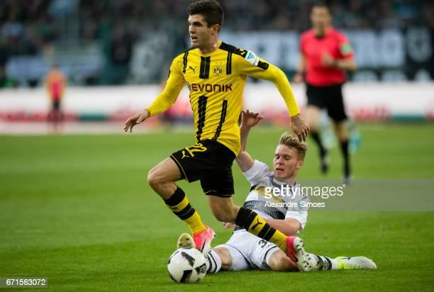 Christian Pulisic of Borussia Dortmund challenges Nico Elvedi of Borussia Moenchengladbach during the Bundesliga match between Borussia...