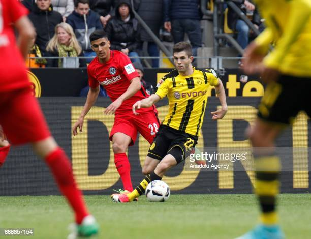 Christian Pulisic of Borussia Dortmund challenges with Aymane Barkok of Eintrach Frankfurt during the Bundesliga soccer match between Borussia...