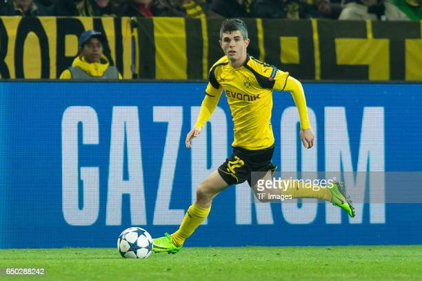 Christian Pulisic of Borussia Dortmund controls the ball during the UEFA Champions League Round of 16 Second Leg match between Borussia Dortmund and...