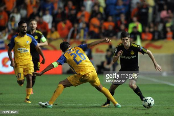 Christian Pulisic of Borussia Dortmund in action against Nuno Morales of Apoel during the UEFA Champions League group H match between APOEL Nikosia...