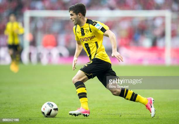 Christian Pulisic of Borussia Dortmund runs with the ball during the Bundesliga match between Bayern Muenchen and Borussia Dortmund at Allianz Arena...