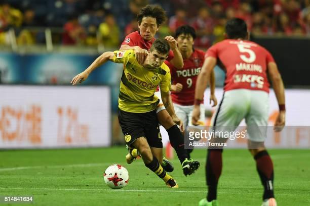 Christian Pulisic of Borussia Dortmund runs with the ball during the preseason friendly match between Urawa Red Diamonds and Borussia Dortmund at...