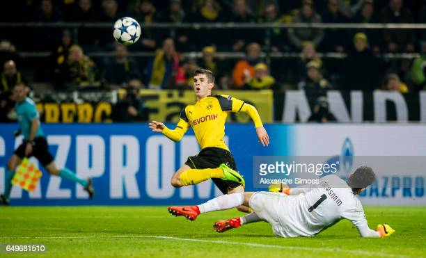 Christian Pulisic of Borussia Dortmund scores the 20 goal during the UEFA Champions League Round of 16 Second Leg match between Borussia Dortmund and...