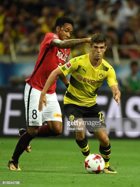 Christian Pulisic of Burussia Dortmund and Rafael Silva of Urawa Red Diamonds compete for the ball during the preseason friendly match between Urawa...