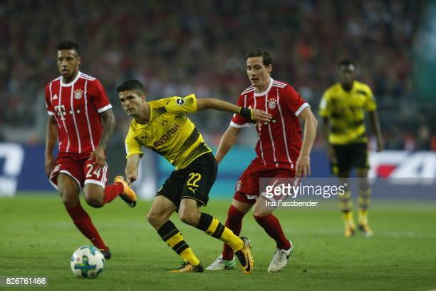 Christian Pulisic of Dortmund and Corentin Tolisso and Sebastian Rudy of Munich challenge for the ball during the DFL Supercup 2017 match between...