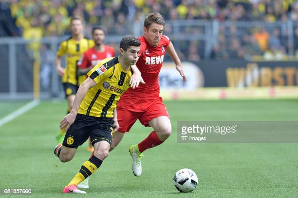 Christian Pulisic of Dortmund and Dominique Heintz of Colonge battle for the ball during the Bundesliga match between Borussia Dortmund and FC Koeln...