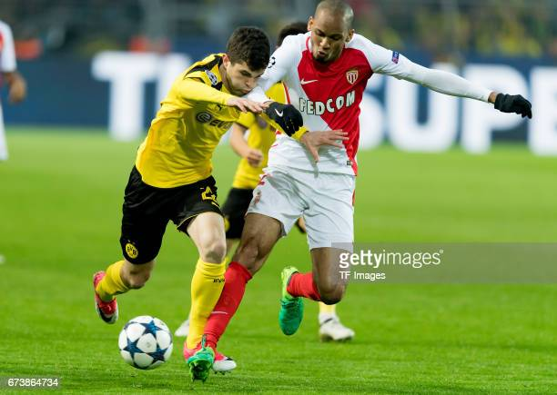 Christian Pulisic of Dortmund and Fabinho of Monaco battle for the ball during the UEFA Champions League Quarter Final First Leg match between...
