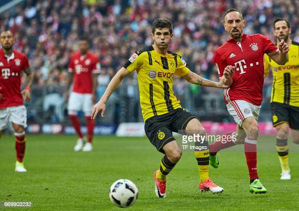 Christian Pulisic of Dortmund and Franck Ribery of Munich battle for the ball during the Bundesliga match between Bayern Muenchen and Borussia...