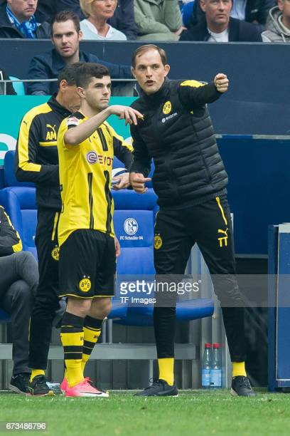 Christian Pulisic of Dortmund and Head coach Thomas Tuchel of Dortmund gestures during the Bundesliga match between FC Schalke 04 and Borussia...