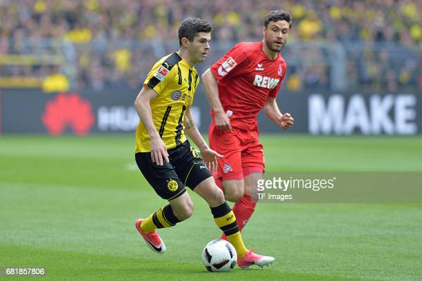 Christian Pulisic of Dortmund and Jonas Hector of Colonge battle for the ball during the Bundesliga match between Borussia Dortmund and FC Koeln at...