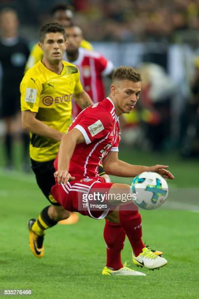 Christian Pulisic of Dortmund and Joshua Kimmich of Bayern Muenchen battle for the ball during the DFL Supercup 2017 match between Borussia Dortmund...