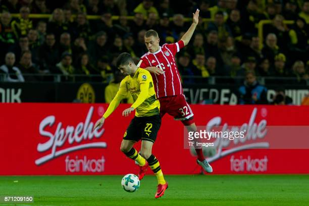 Christian Pulisic of Dortmund and Joshua Kimmich of Bayern Muenchen battle for the ball during the German Bundesliga match between Borussia Dortmund...