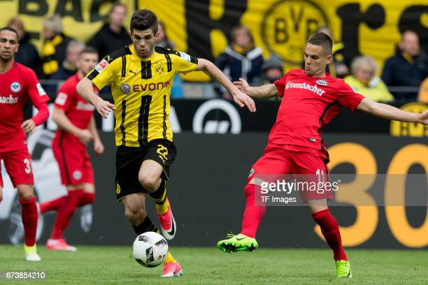 Christian Pulisic of Dortmund and Mijat Gacinovic of Frankfurt battle for the ball during the Bundesliga match between Borussia Dortmund and...