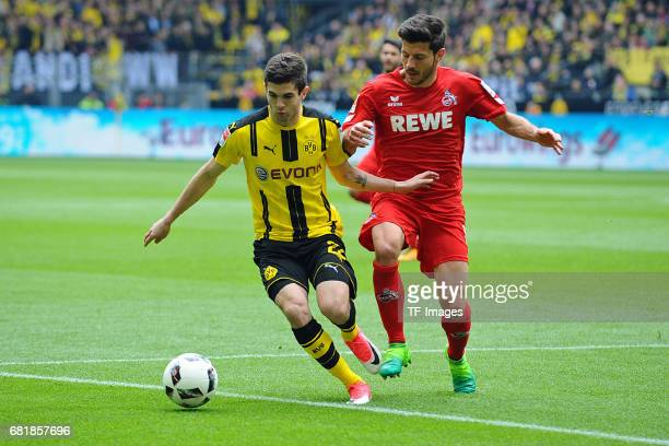 Christian Pulisic of Dortmund and Milos Jojic of Colonge battle for the ball during the Bundesliga match between Borussia Dortmund and FC Koeln at...