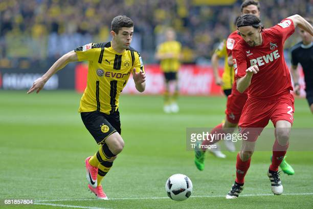 Christian Pulisic of Dortmund and Neven Subotic of Colonge battle for the ball during the Bundesliga match between Borussia Dortmund and FC Koeln at...