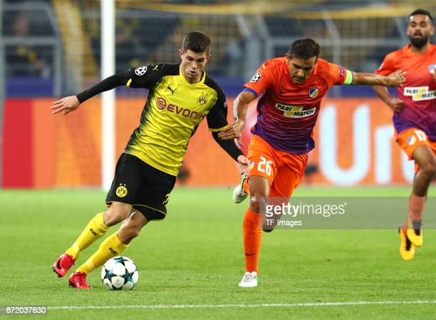 Christian Pulisic of Dortmund and Nuno Miguel Barbosa Morais of APOEL Nicosia battle for the ball during the UEFA Champions League Group H soccer...