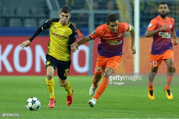 Christian Pulisic of Dortmund and Nuno Morais of Nikosia battle for the ball during the UEFA Champions League Group H soccer match between Borussia...