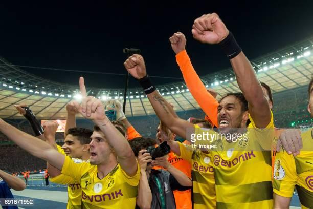 Christian Pulisic of Dortmund and PierreEmerick Aubameyang of Dortmund celebrates after winning the DFB Cup final match between Eintracht Frankfurt...