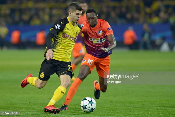 Christian Pulisic of Dortmund and Vinicius of Nikosia battle for the ball during the UEFA Champions League Group H soccer match between Borussia...