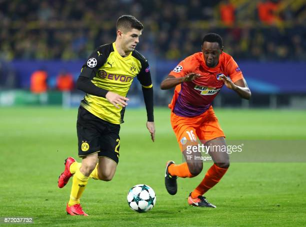 Christian Pulisic of Dortmund and Vinicius Oliveira Franco of APOEL Nicosia battle for the ball during the UEFA Champions League Group H soccer match...