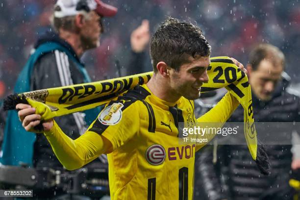 Christian Pulisic of Dortmund celebrates the win after the final whistle during the German Cup semi final soccer match between FC Bayern Munich and...