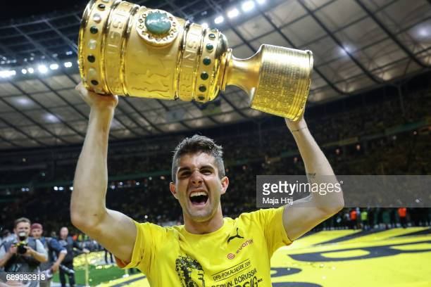 Christian Pulisic of Dortmund celebrates with a trophy after winning the DFB Cup final match between Eintracht Frankfurt and Borussia Dortmund at...